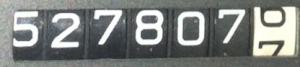527807